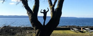 woman poses in tree
